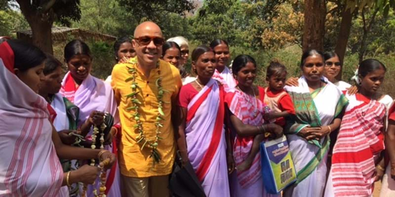 "Darren Walker with local women in the village of Teliya. ""We don't know the strength we have in ourselves,"" one of them told me. But they are finding it every day. This image is not available under the 4.0 Creative Commons license."