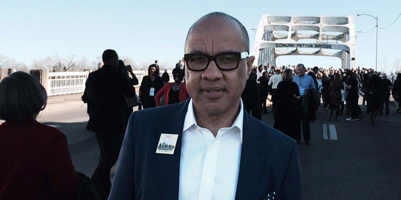 Darren Walker in front of the Edmund Pettus Bridge during the 50th anniversary of the march from Selma to Montgomery.  This image is not available under the 4.0 Creative Commons license.