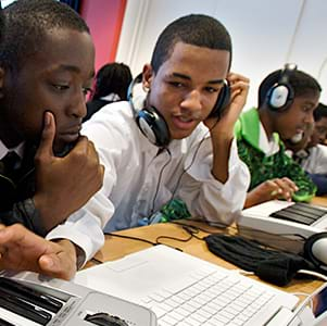 Young people training with computers and music equipment. 2008. Photo Credit: ©Alexis Maryon/PYMCA.