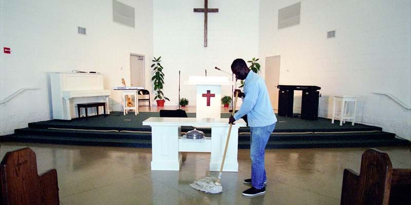 Incarcerated person mops the floors of the prison church. Louisiana, USA. Photo Credit & (c): kadir van lohuizen/ NOOR