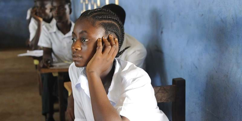 A girl attends a class in a school in Monrovia on April 15, 2016. For the new school year, the Liberian government plans to roll out a public-private partnership involving 120 primary schools, costing an initial $65 million -- the equivalent of more than three quarters of the entire education budget. Photo credit: ZOOM DOSSO/AFP/Getty Images