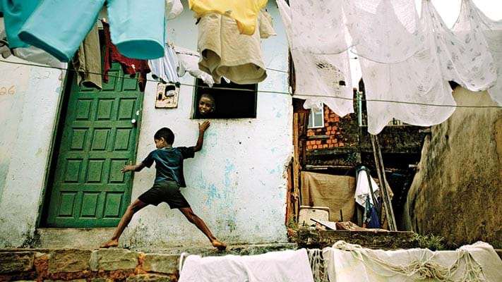 Child playing in favela. 1969. Photo Credit: © Panos