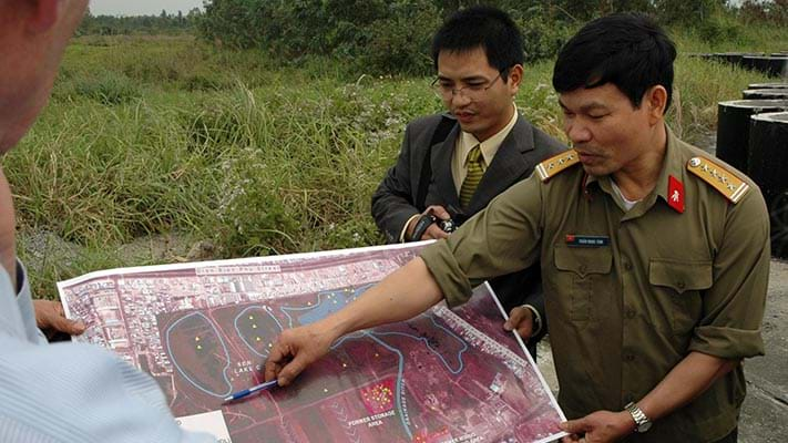 U.S.-Vietnam Dialogue Group task force reviewing a map in the field. 2007. Photo Credit: © Ford Foundation