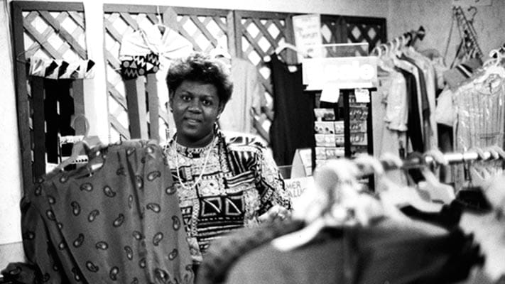 Beneficiary of Center for Community Self-Help in Durham, North Carolina working in her own clothing shop. 1984. Photo Credit: © Ford Foundation