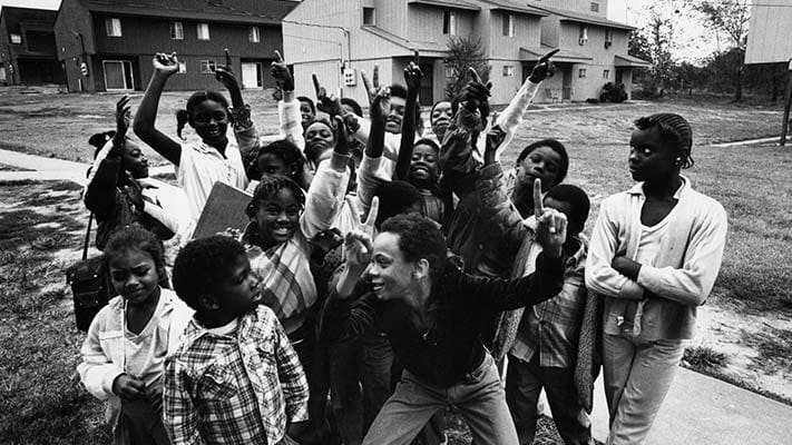 Group of young people celebrating in Pride Gardens. 1968.