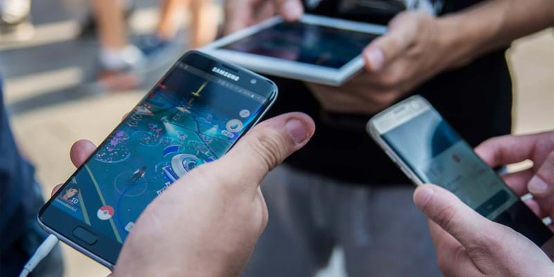 People playing with their mobiles during a Pokemon Go gaming mass gathering in Puerta del Sol square, Madrid. Over 3000 gamers have gathered breaking a new record. 2016. Photo credit: Marcos del Mazo/Pacific Press/Newscom