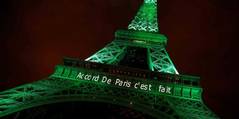 The Eiffel tower illuminated to celebrate COP21 Climate Change agreement. Nov., 2016. Photo credit: REUTERS/Jacky Naegelen