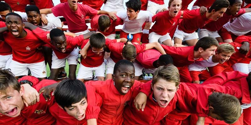 Students at the King Edward VII school take part in the traditional 'War Cry' ahead of an inter-school rugby match in Johannesburg (Photo by Leon Neal/Getty Images)
