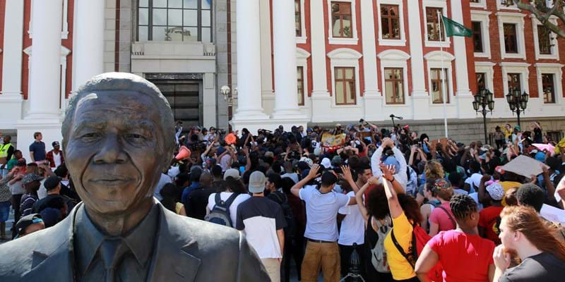 CAPE TOWN, SOUTH AFRICA - OCTOBER 21: Protesting students broke through the gates of parliament during protests against a proposed hike in tuition fees this is part of the fees must fall movement. (Photo by Nardus Engelbrecht/Gallo Images/Getty Images)