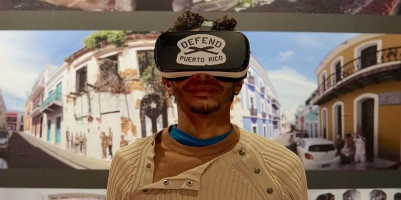 A visitor to the Defend Puerto Rico exhibition at the Caribbean Cultural Center African Diaspora Institute uses an augmented reality headset.