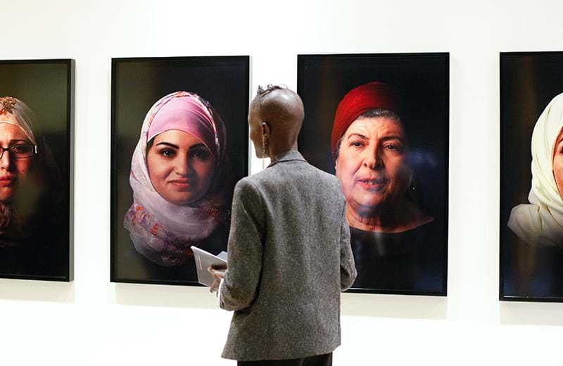 Person in gallery admiring pictures