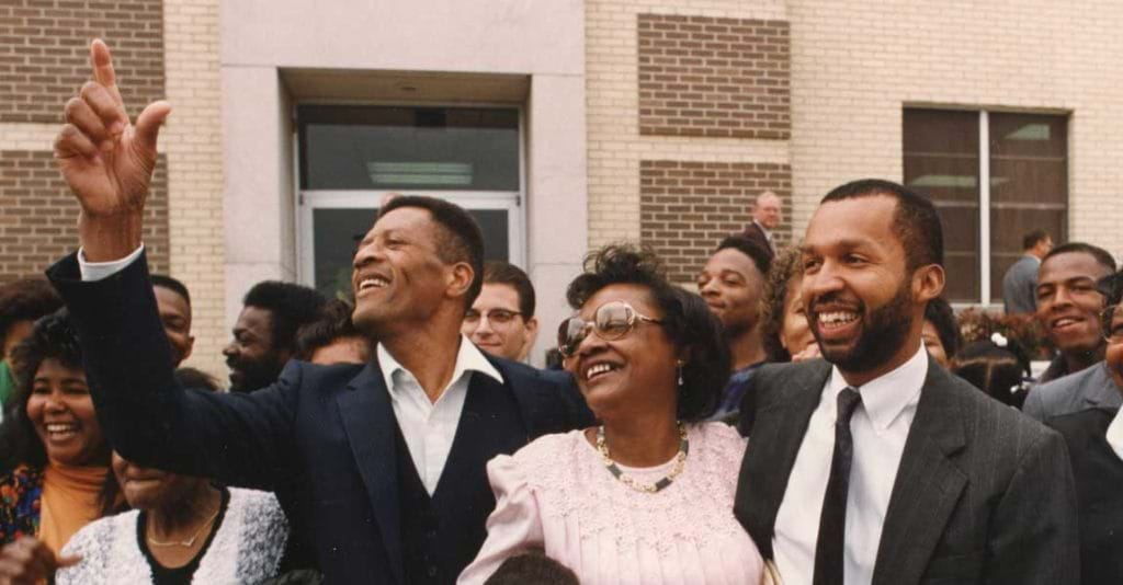 Walter McMillian (left) celebrates with family after Bryan Stevenson won his release from death row in 1993.