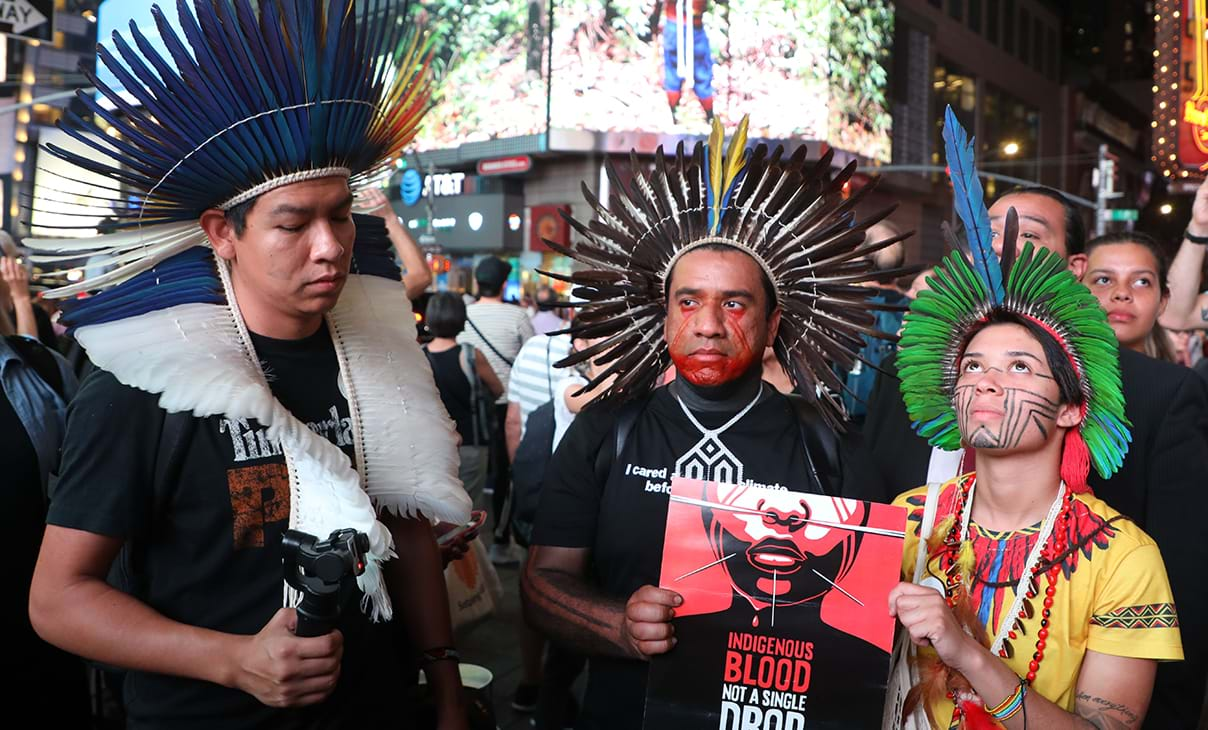 Eric Terena (L), Dinamam Tuxa (C) and Artemisa Xakriaba demonstrate in Times Square.