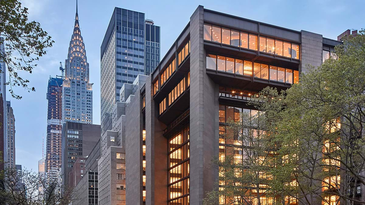 An exterior shot of the Ford Foundation headquarters in New York City with the Chrysler building in the background.