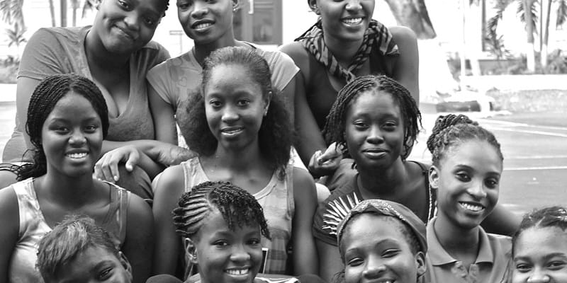 A group of young Black women seated together smiling.